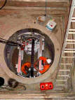 A typical Pilot Auger microtunneller arrangement in a shaft. Picture courtesy of Naylor Drainage Ltd, UK